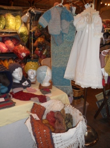 The White Christening Gown with slip and bonnet, on the right has been totally hand sewn by Suzie